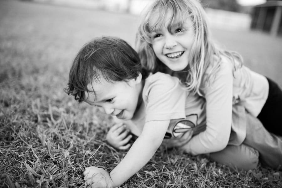 Kiddos play in the backyard during an in home lifestyle photography session.