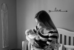 newborn quiet moment with mom in the nursery