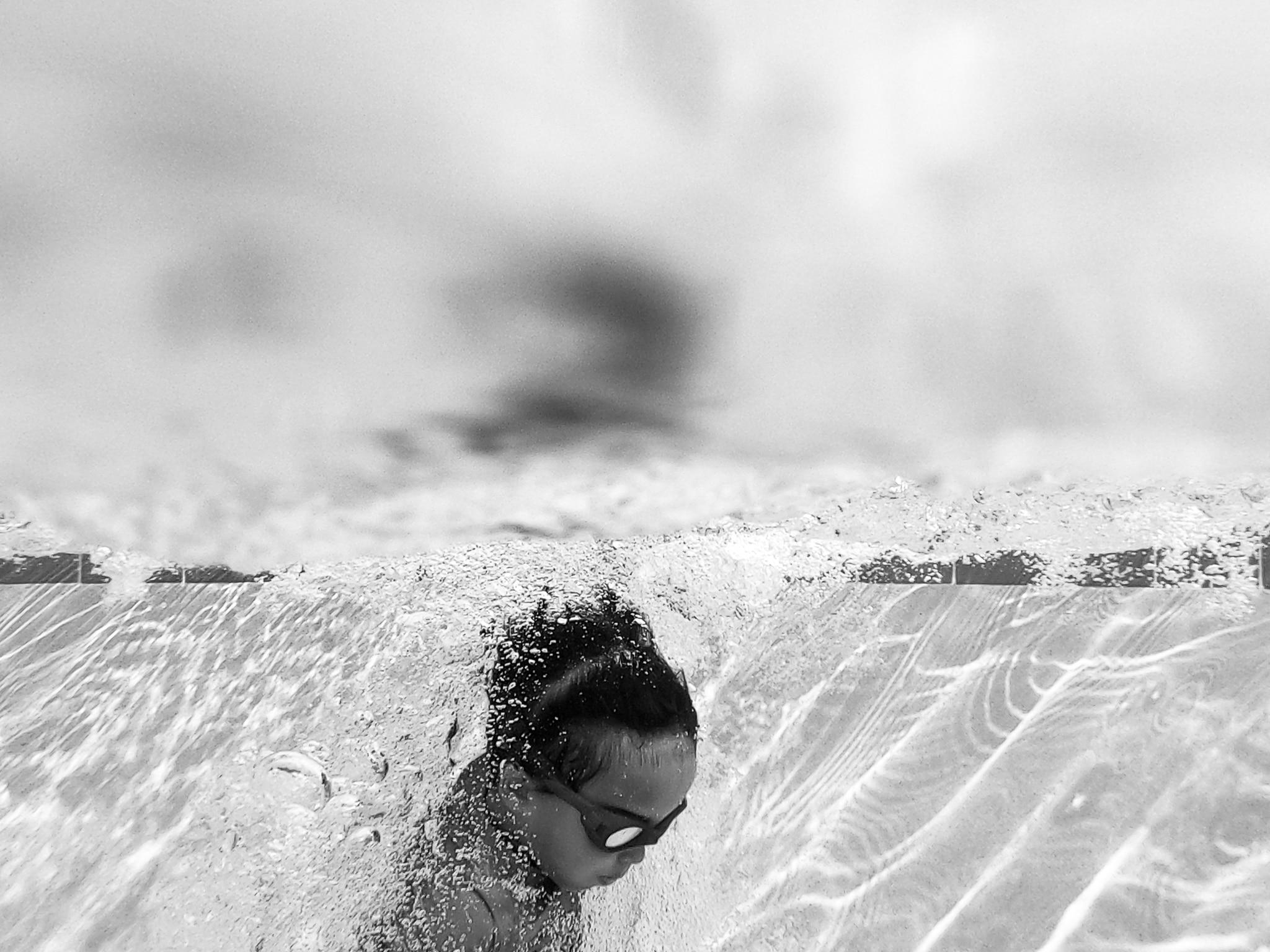 boy jumps in water