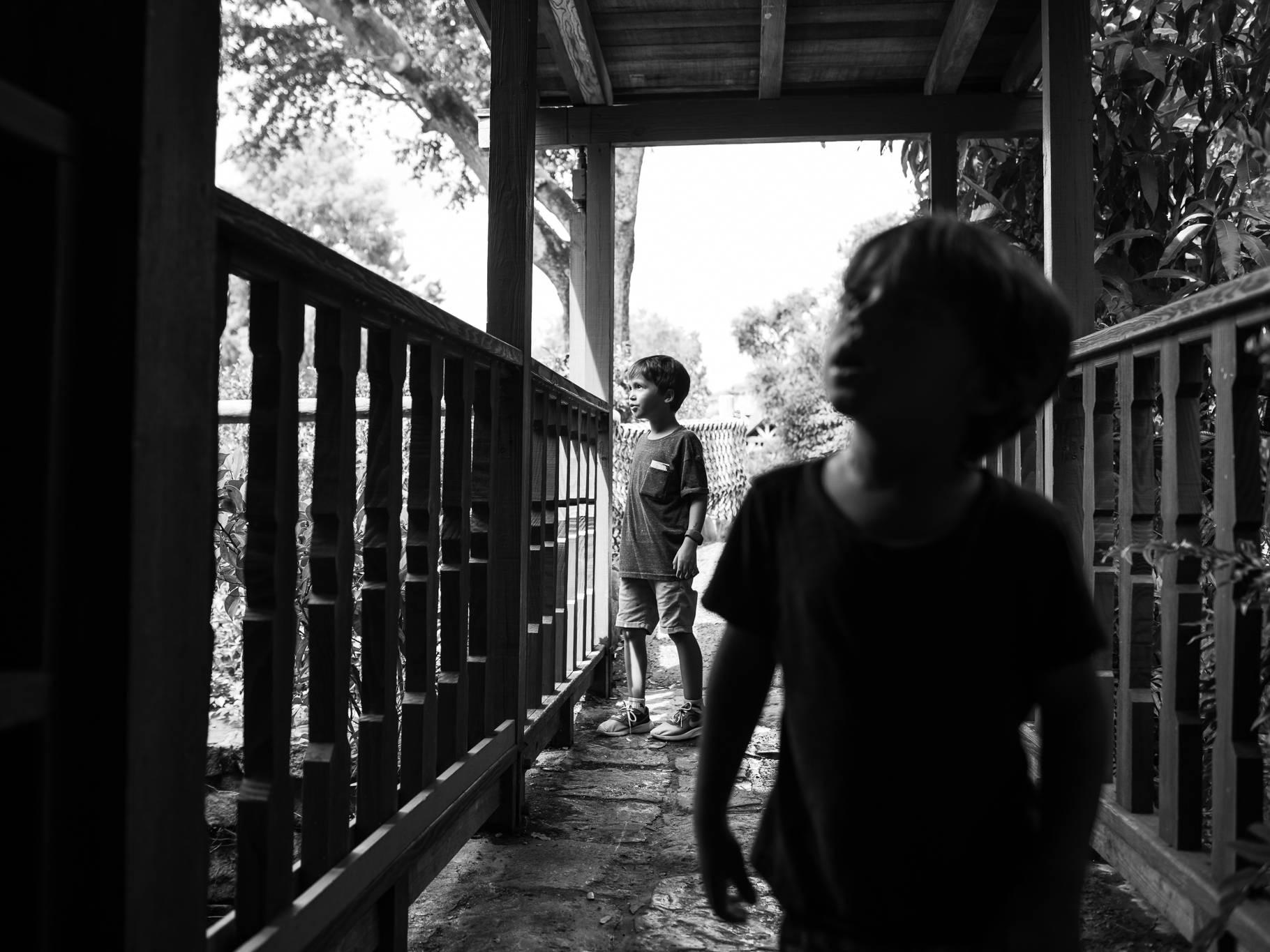 boys explore Tom Sawyer Island inside the Magic Kingdom