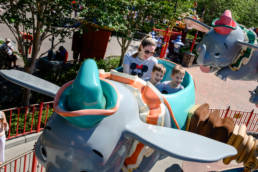 mom rides Dumbo with sons