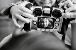 boys play with camera designed for kids