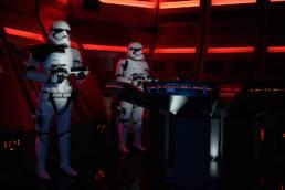 Stormtroopers keep watch as prisoners board