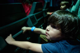 boy takes in all the sights on the Star Wars ride in Disney World