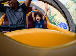 boy puts hands up on Slinky Dog