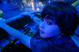 boy enjoys ride on Alien Saucers before dawn