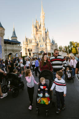 family walks past Cinderella's Castle