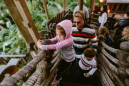 family climbs through the Swiss Robinson Treehouse
