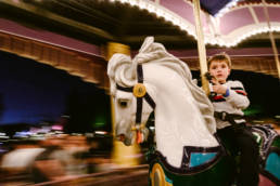 boy gets a little scared on the carousel