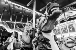 girl gets the horse she wants on carousel