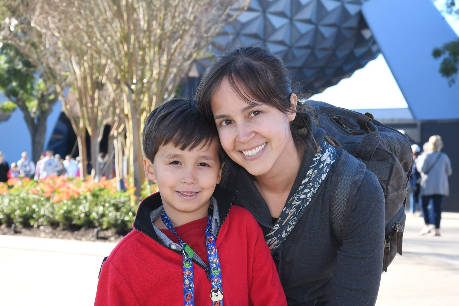 my son and I pose for Photo Pass photographer at EPCOT