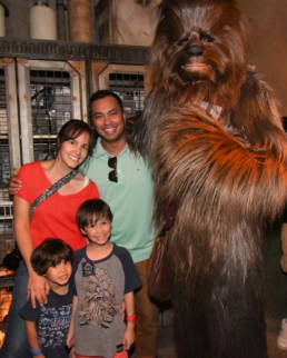my family poses with Chewbacca inside the Rise of the Resistance queue