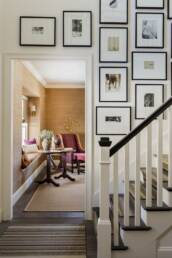Gallery wall on a stairwell designed by Lisa Tharpe