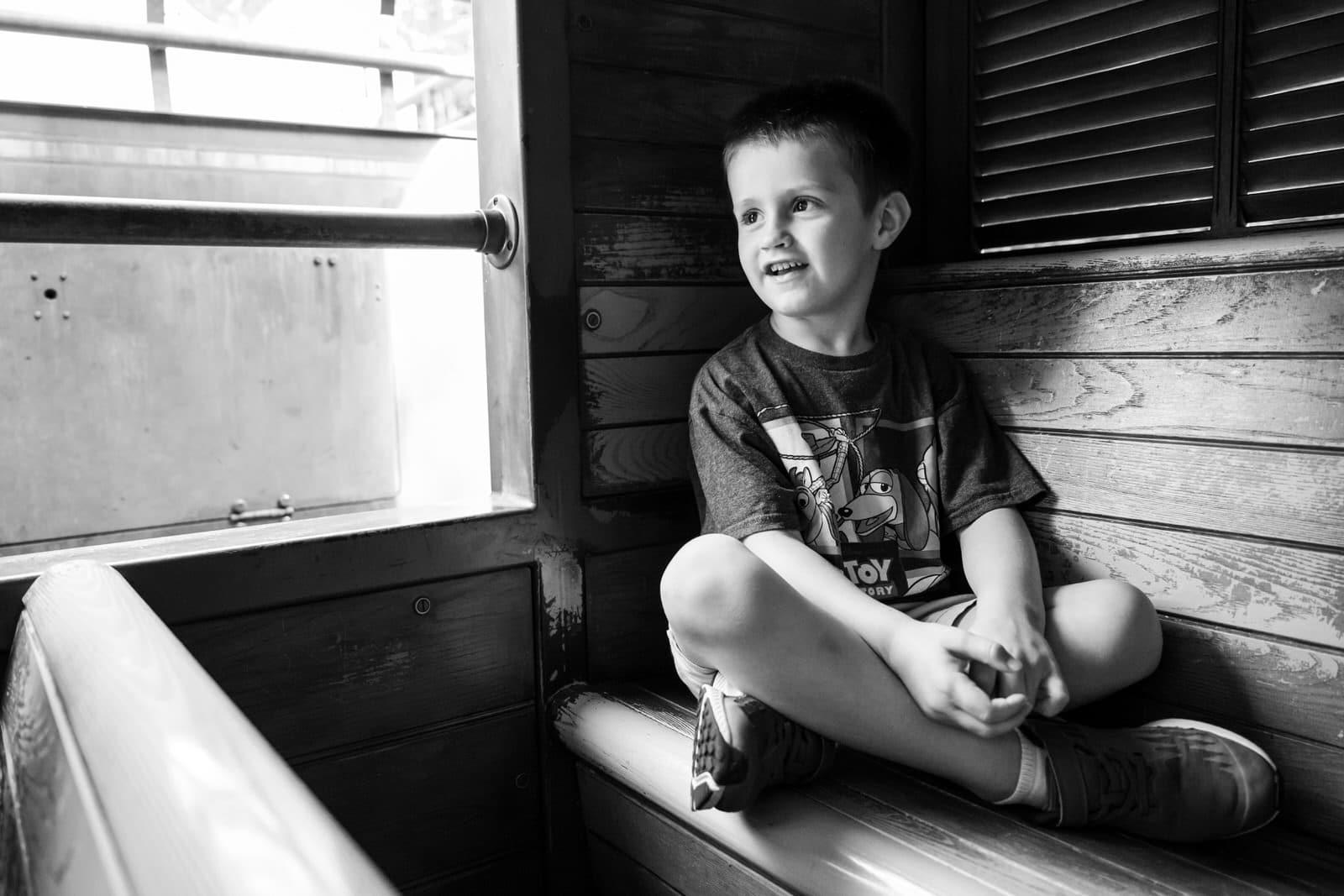 boy rides train at Animal Kingdom