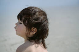boy's hair blows in the wind before first haircut