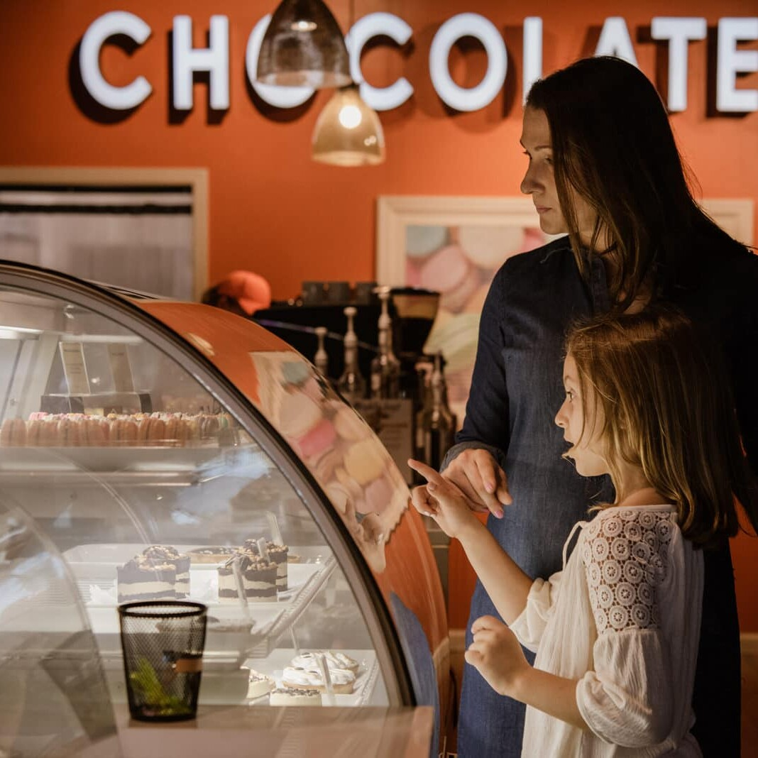 mother and daughter buy chocolates