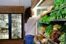 Karen Millsap shops for produce at Farmacy