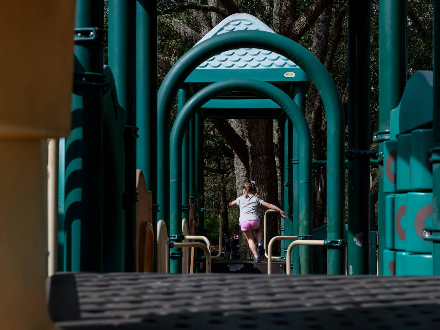 girl runs away on playground