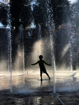 boy plays in splash pad