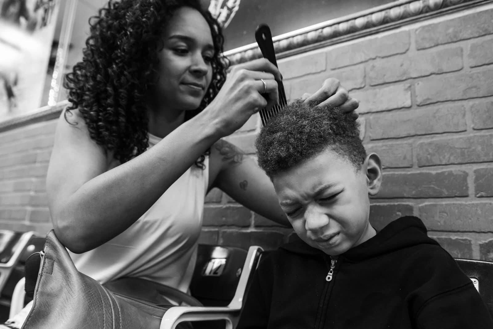 mom prepares her son for a hair cut