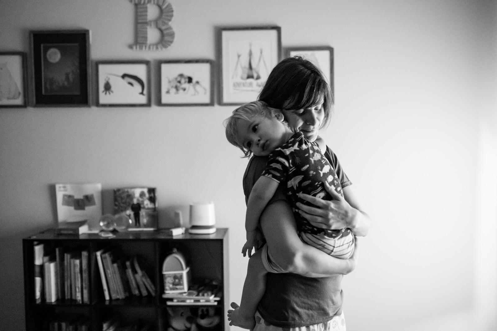 mom comforts half-asleep son