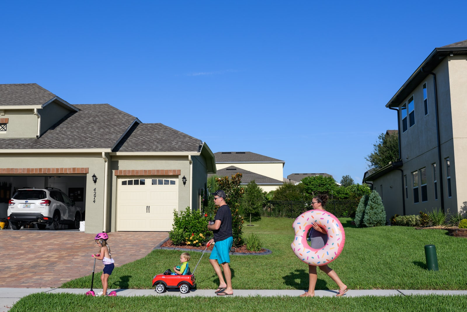 family takes a walk to the community pool