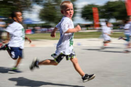 boy runs fast in school race