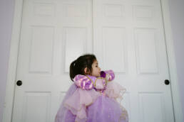 girl gets princess costume on