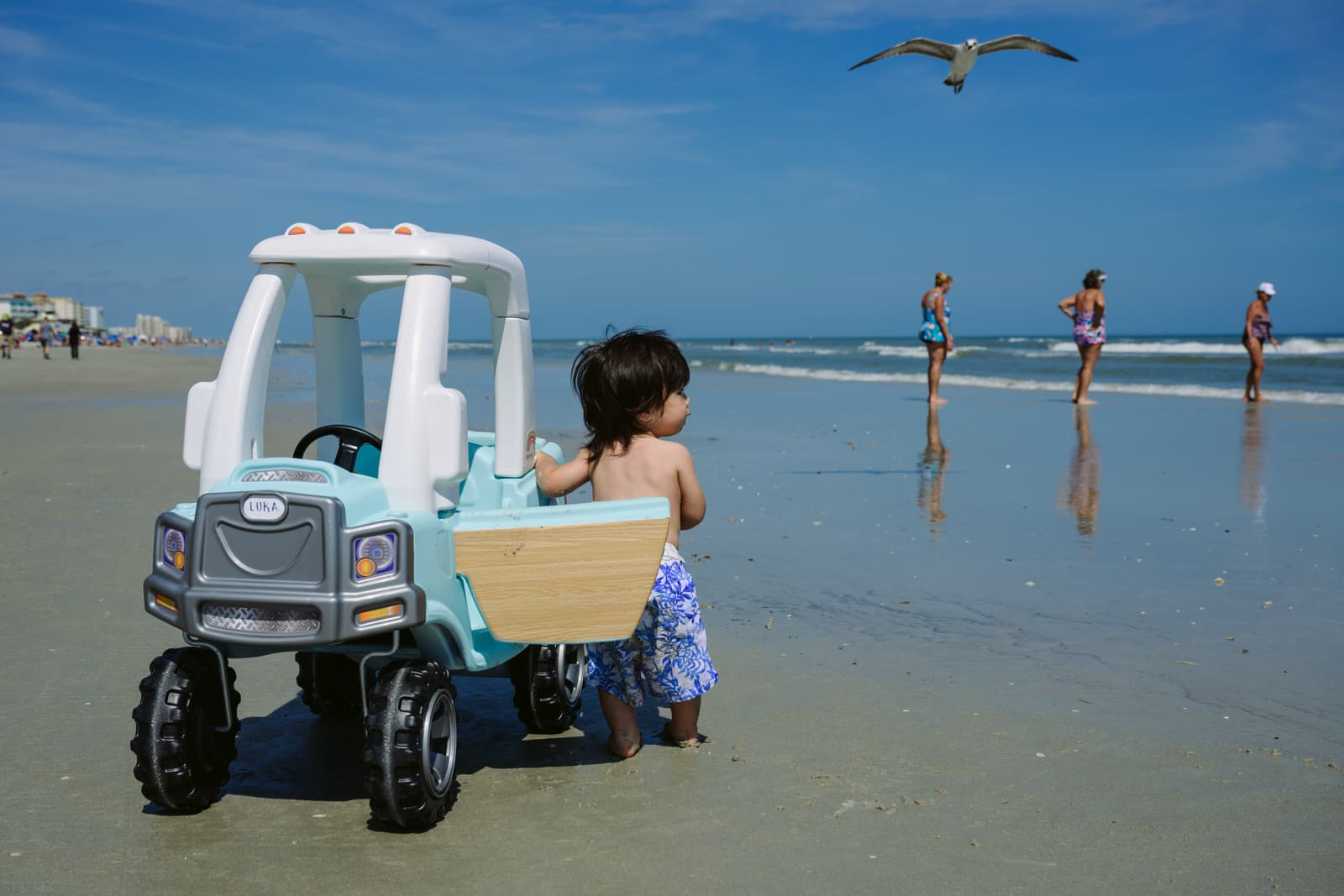 boy on the beach with his cruiser