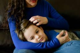 mom brushes son's hair