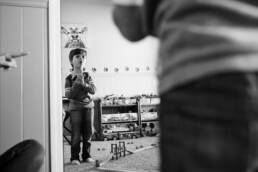 boy plays in the mirror