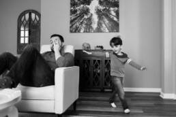 dad shows his tiredness as son runs around him