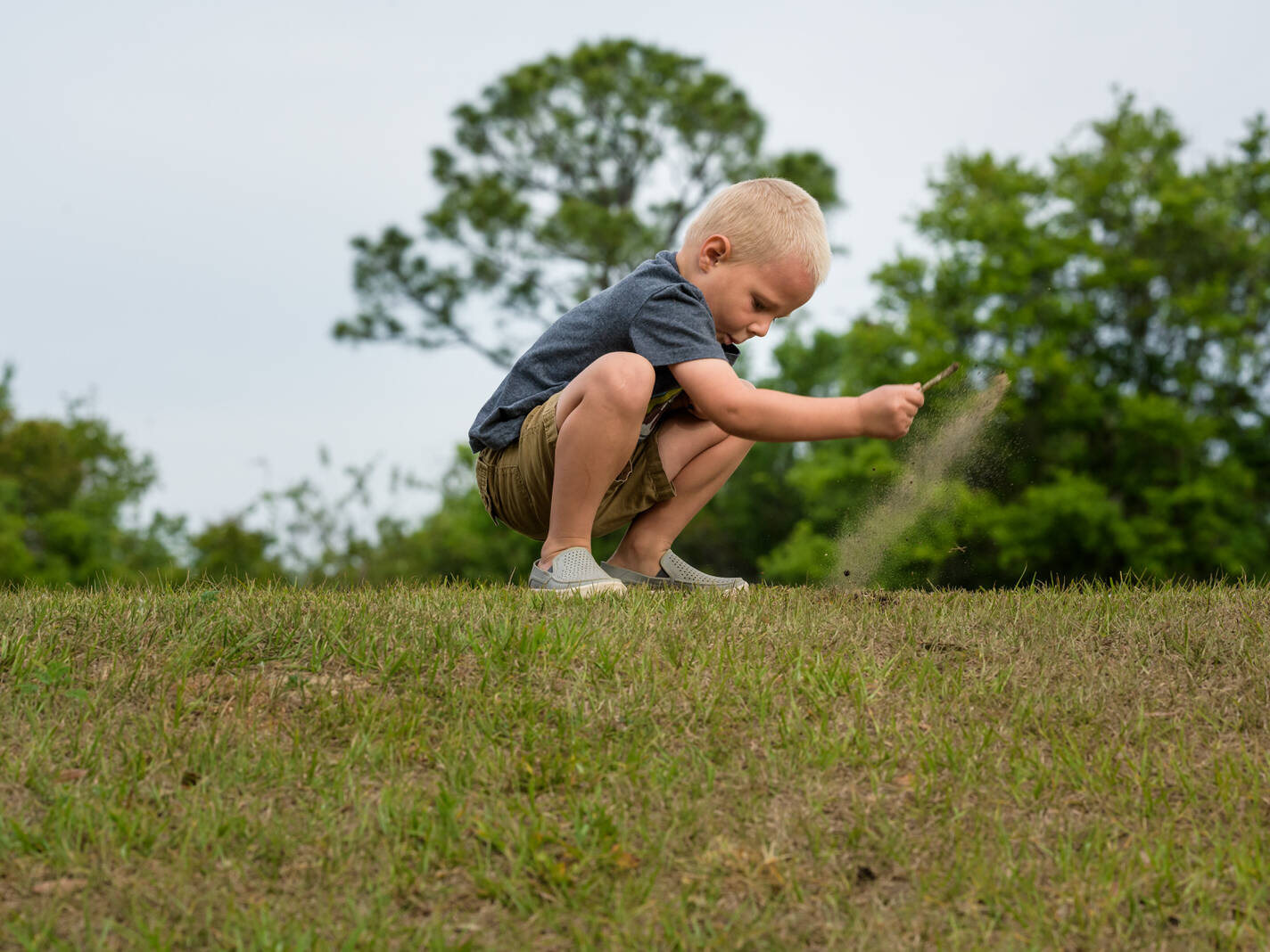 boy launches dirt at the park