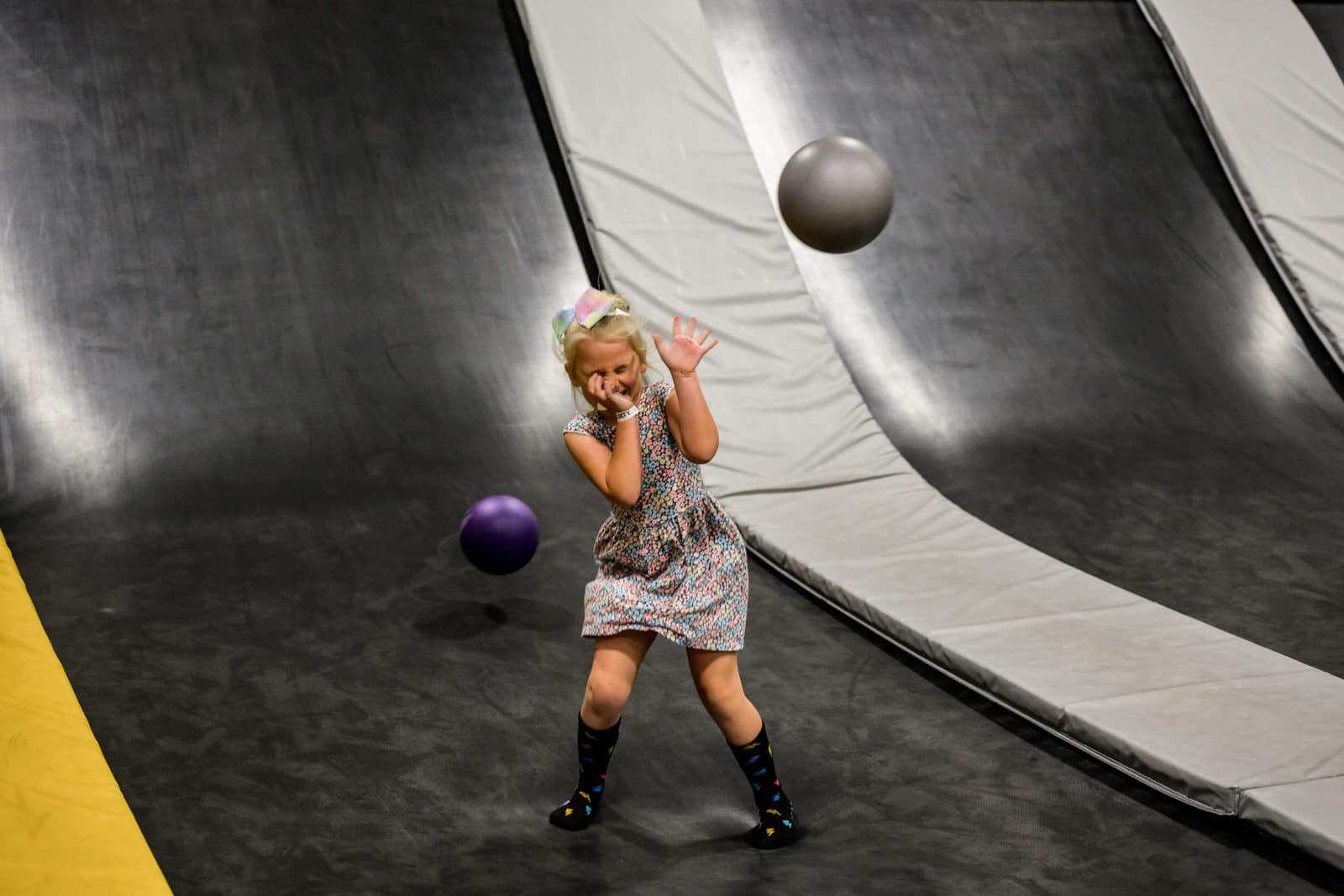 girl prepares to be hit by a dodge ball