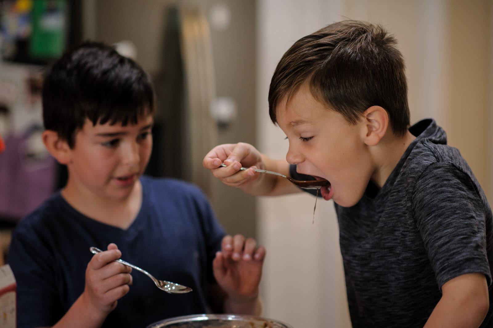 boys steal a taste of brownie batter