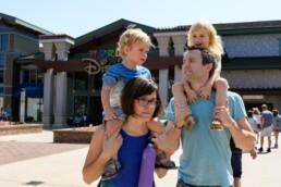 family walks around Disney Springs