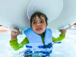 boy hides under raft at Blizzard Beach