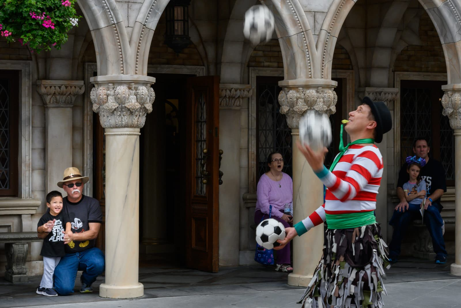boy and grandfather watch juggling show