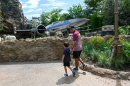 father and son check out scenery at Galaxy's Edge