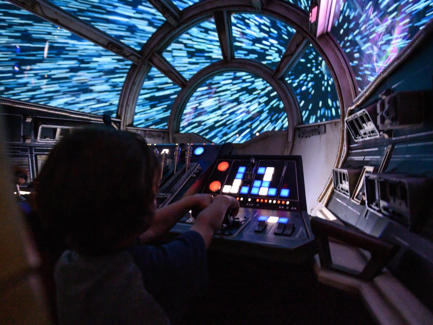 boy flies the Millennium Falcon