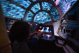 boy flies the Millennium Falcon