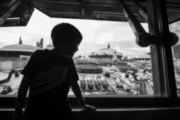 silhouette of boy looking out at Galaxy's Edge