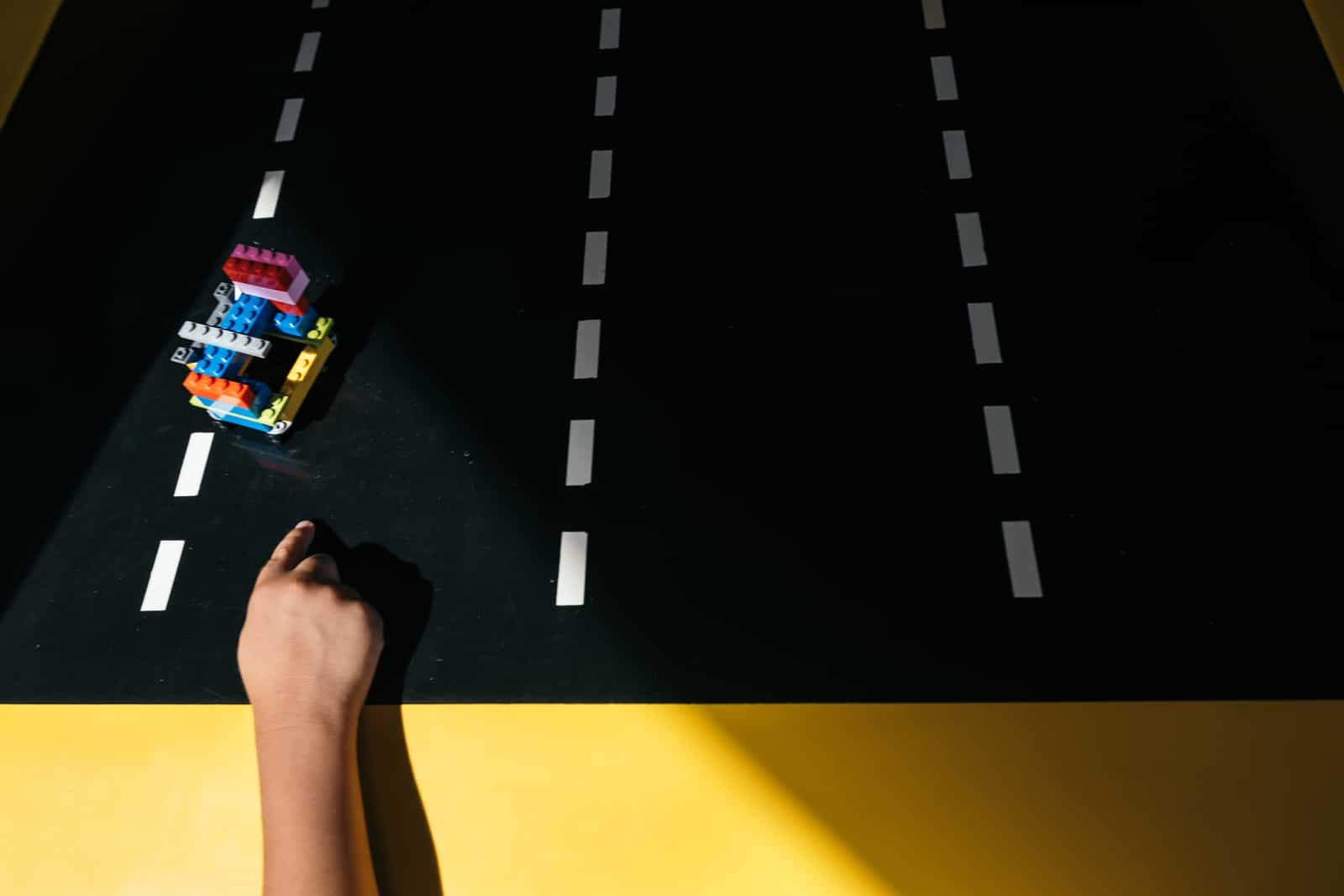 boy launches car at Lego Store