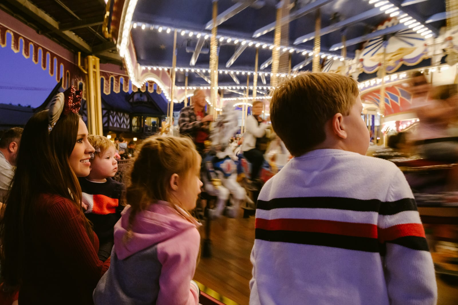 mom and kids wait to ride Prince Charming's Carousel