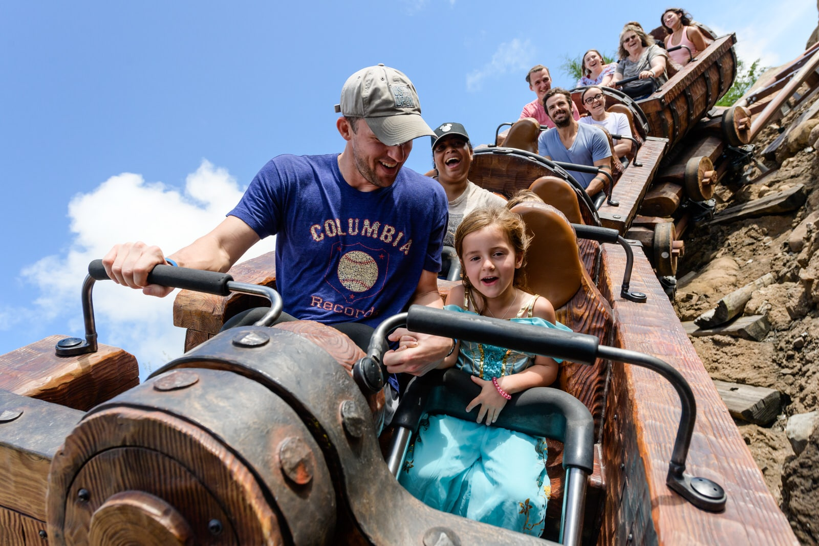 dad and daughter ride Seven Dwarfs Mine Train
