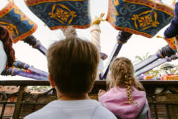 kids look up to Magic Carpets flying above