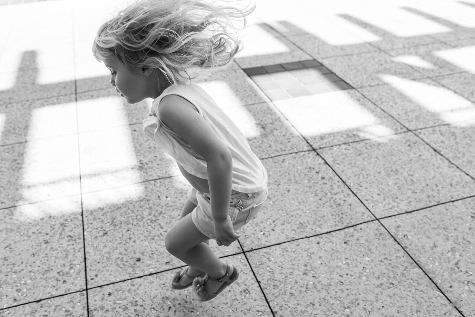 girl hops along at Disney Springs