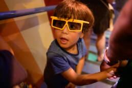 boy prepares to ride Toy Story Mania