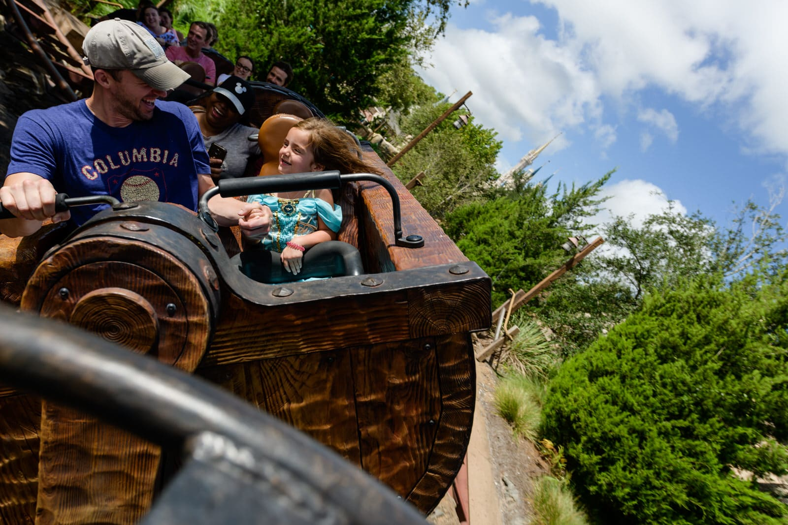 father and daughter ride the Mine Train