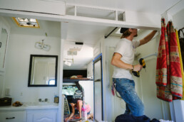 husband and wife work on updating their RV
